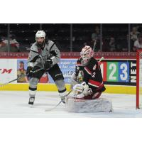 Chris Thorburn of the San Antonio Rampage looks for a rebound in front of Grand Rapids Griffins goaltender Patrik Rybar