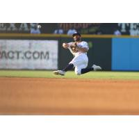 2B Jose Altuve makes a throw while falling for the Round Rock Express